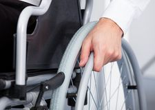 Businessman on wheelchair Stock Photos