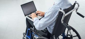 Businessman in wheelchair Stock Image