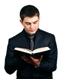 Businessman which reads book Royalty Free Stock Photos