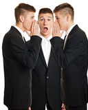 Businessman whispering royalty free stock photography