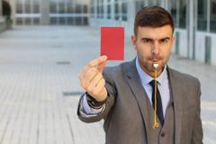 Businessman with whistle and red card.  stock photos