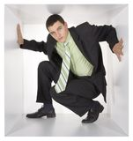 Businessman in the white cube Royalty Free Stock Photos