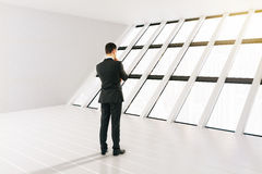 Businessman white interior. Thinking businessman in white interior with panoramic windows. 3D Rendering Stock Image
