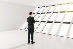 Businessman white interior Stock Image