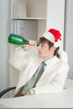 Businessman in white jacket celebrates Christmas Stock Photo
