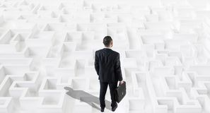 Businessman on a white large maze or labyrinth.Strategy Concept. Businessman on a white large maze or labyrinth.Strategy Concept stock image