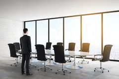 Businessman in white meeting room vector illustration