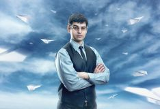 Businessman with white paper planes Stock Photos