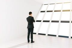 Businessman white room Stock Photo