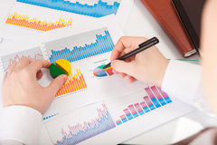 Businessman analyzing charts and graphs Stock Photo