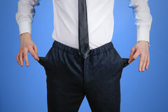 The businessman in a white shirt and black trousers shows his em Stock Photos