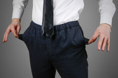 The businessman in a white shirt and black trousers shows his em Royalty Free Stock Photos
