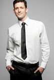 Businessman in white shirt on gray background. Royalty Free Stock Photos