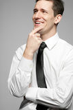 Businessman in white shirt on gray background. Stock Photos
