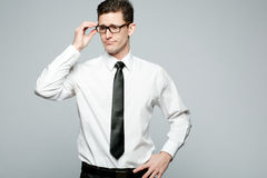 Businessman in white shirt on gray background. Stock Photo