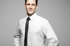 Businessman in white shirt on gray background. Stock Photography