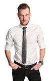 Businessman in white shirt with rolled up sleeves. An handsome businessman wearing a white shirt and grey tie. Standing in a studio. White background Royalty Free Stock Images