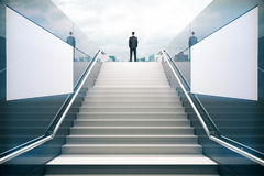 Businessman on white stairs Royalty Free Stock Photography