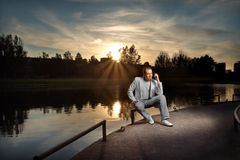 Businessman in white on the sunset Stock Photography