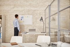 Businessman by whiteboard Stock Images