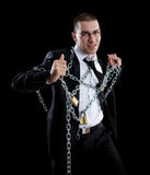 Businessman who breaks the chains Stock Images