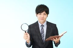 Businessman who checks the schedule. Portrait of an Asian businessman Stock Image