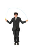Businessman, who jumps through  jumping rope Royalty Free Stock Photo