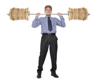 Businessman who raises money as weights Royalty Free Stock Photo
