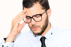 Businessman who stands head. Businessman holds his head because of the difficulty of the work stock image