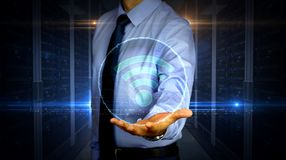 Businessman with wi-fi hologram stock photo