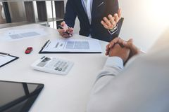 Businessman will be signing a car insurance policy, Agent man is. Holding the document and waiting for his reply to finish Royalty Free Stock Photo