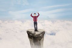 Businessman win above clouds Royalty Free Stock Photos