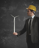 Businessman and wind turbine Stock Photos