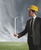 Businessman and wind turbine Royalty Free Stock Photo
