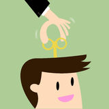 Businessman With Wind-up Key In Head Royalty Free Stock Photos