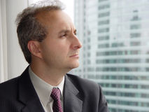 Businessman by the window royalty free stock photography