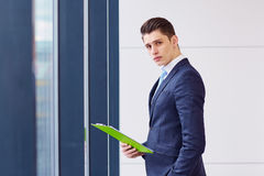 Businessman by window in the office. Business portrait Stock Photo