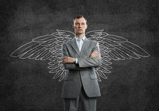 Businessman with wings Royalty Free Stock Photography