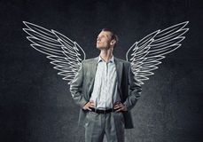 Businessman with wings Stock Photography