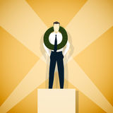 Businessman winner of competition, is standing on pedestal Stock Image