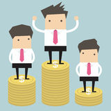 Businessman winner standing on gold coin Royalty Free Stock Image