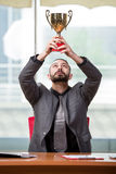 The businessman with winners cup trophy in business concept Stock Photography
