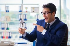 The businessman winning best employee of the month award. Businessman winning best employee of the month award Stock Photography