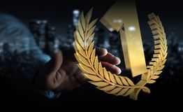 Businessman winning the first golden price 3D rendering. Businessman on blurred background winning the first golden price 3D rendering Royalty Free Stock Images