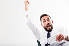 Businessman winning on his smartphone Stock Photo