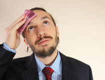 The businessman wipes a forehead by Stock Photography