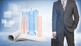 Businessman and wire-frame buildings on open empty Stock Image