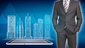 Businessman and wire-frame buildings on screen Royalty Free Stock Photo