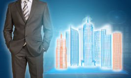 Businessman and wire-frame buildings on Stock Photos