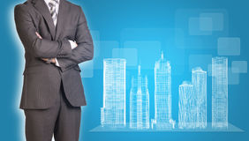Businessman and wire-frame buildings on Royalty Free Stock Image